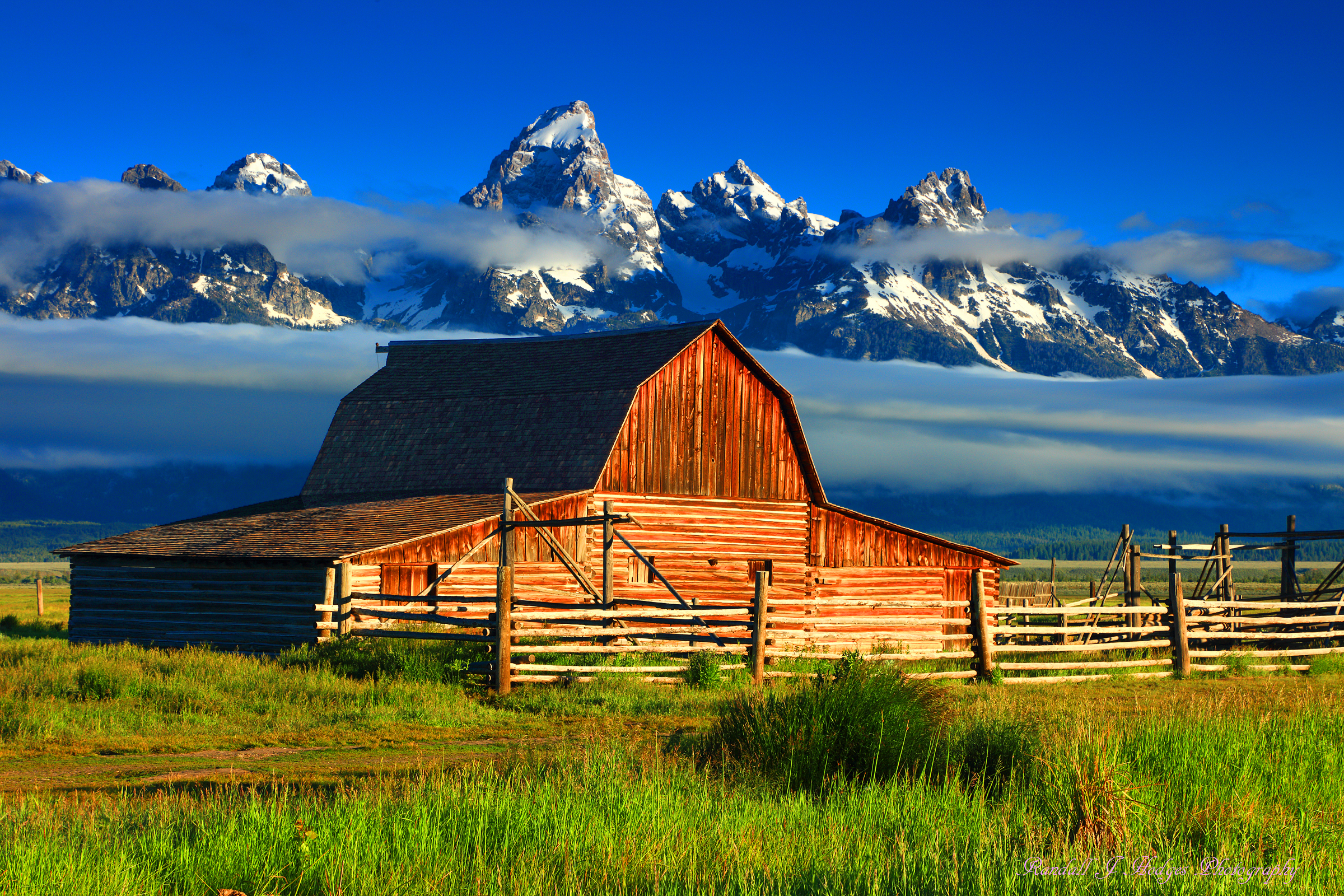 Morning Light and the John Moulton Barn With the Grand Tetons from Morman Row in Grand Teton National Park in Wyoming